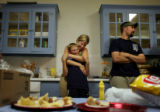 Alissa Vertovec, cq, hugs her nephew Josh Miketa, cq, 11, in the kitchen of Eiler's PLace, a bar...