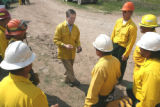 Gov. Bill Owens (center) talks to ground crew members fighting the fire just  north of  Hwy. 160 ...