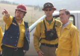 L to R: Fire Incident Commander Pete Blume (cq), Fire Information Officer Steve Segin (cq)  and...