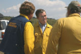 Gov. Bill Owens (center)  talks to Fire  Incident Commander Pete Blume (cq),left, and Brian Ayers...