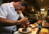 Chef Sean Yontz, at Chama restaurant in Belmar, Lakewood,  prepares dehydrated camping food, from...