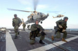 021029-N-3235P-507 At sea aboard USS Oscar Austin (DDG 79) Oct. 29, 2002 -- U.S. Navy SEALs,...