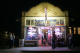 Families gather outside Eiler's Place in Pueblo after a street festival along Mesa Avenue on...