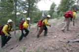 The Chief Mountain  Hotshot crew from Browning, Montana climbs to the Mato Vega Fire at an...