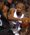 Tony Massenburg of the Kings tries to go up for a shot while being guarded by Ervin Johnson during...