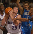 Darius Songaila of the Kings prepares for a shot while Keith Bogans, right,  and Gordan Giricek(7)...