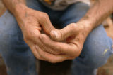 The hands of artist William Goodman, CQ, 67, are folded as he remembers his very good friend and...