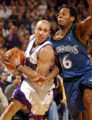 Sacramento Kings Mike Bibby drives to the basket against Timberwolves Troy Hudson in the 2nd half ...