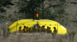 Members of the Redding Hotshots  form Redding California gather at the helicopter base on   the...