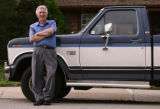 KAS087 Russ Schnell (cq) stands next to his Ford F-150 pickup truck in front of his Boulder home...