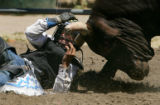 FOR PROJECT NOT FOR SLIDE SHOW OR DAILY USE.Joshua Hayden (#23), of Fruita, tries to protect...