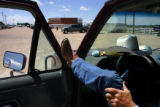 Terry Harris, an employee of Winter Livestock auction in La Junta, waits to help customers load...