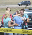 Two unidentified women hugged and cried who were witnesses to the accident and soon after taken to...
