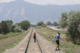 An unknown cyclist decided to walk beyond the accident scene against the idyllic mountain...
