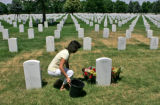 Cindy Dietz kneels at the head stone of her son Danny Dietz Saturday afternoon June 24, 2006 as...