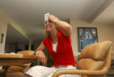 (Denver, Colo., April 18, 2004) Nursing student Kacey Ruegsegger (cq), 22, laughs while playing...