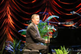 "Former U.S. Attorney General John Ashcroft, sings ""America the Beautiful,"" while playing..."