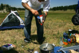 Chef Sean Yontz mixes up some dehydrated camping food in Evergreen  on June 23, 2006.   He's doing...