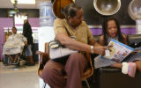 KAS115 Marilyn Banks (cq) helps her daughter, Nyjhia Bridges, 8, with an activity book while she...