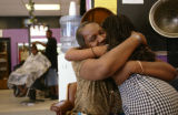 KAS135 Marilyn Banks (cq) hugs her daughter, Nyjhia Bridges (cq), 8, after working on an activity...