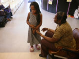 KAS142 Marilyn Banks (cq) talks to her daughter, Nyjhia Bridges, 8, while waiting for her son to...