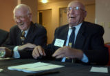 04/15/2004 Tucson, Arizona-Doolittle Raiders Tom Griffin, left, and Bill Bower laugh and sing...