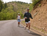 KAS032 Scott Snyder (cq), right, and Jack Menard (cq) run down Deer Creek Canyon Road on Sunday,...