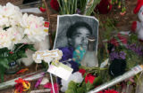 (Denver, Colo., April 22, 2004) Flowers and cards surround a picture of Carold Peoples Jr.,16,  at...