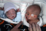 Adam Rugg  (left) and his brother Jayson Rugg share a crib Wednesday afternoon at Presbyterian St....