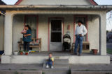 Janet Vasquez, cq, left, stands on the front porch of her Pueblo home with her grandsons Daniel...
