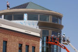 Construction workers atop the Gap Building at Southlands Main Street located near E-470 and Smoky...