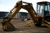 A tractor sits still as construction is underway at the Fort Carson Middle School in Colorado...