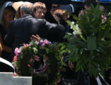 John Ramsey hugs his son, Burke, facing camera,at the graves of his wife, Patsy, and daughter...