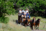 CODER101 - Eric Bartels (cq, left in black driving) of Mancos, Colo., leads a family on a...