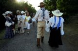 Dressed in period clothing Dwayne Severn (cq, center) and Judith Good (cq, right), both of San...