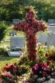 Fresh flowers adorn the grave site of Patsy Ramsey at St. James Episcopal Cemetery after burial...