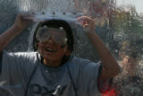 DLM2107  Zavier Hose, 8, of Denver, laughs after getting soaked at a display set up at the Dew...