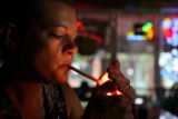 Dala Hood, cq, of Denver lights up her cigarette in the smoking section of Charlie Brown's, 10th...