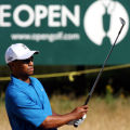 MJS113 - Tiger Woods hits a bunker shot as he practices at the Royal Liverpool Golf Club before...