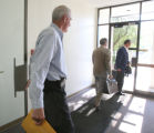 Pete Coors walks out of the Division of Motor Vehicles office in Lakewood after a hearing on the...