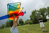 Kite-flying at Addenbrooke Park in Lakewood, Colo., on Sunday, June 20, 2004.  Hunter (6) and his...