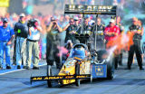 Defending Top Fuel Mile High National champion Tony Schumacher blasts off  the line in the final...