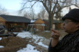 **1/25/06** Gloria (who would not give her last name) stands in front of her home Wednesday. The...