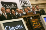 Chipotle Mexican Grill Inc. (CMG) founder and chief executive officer Steve Ells, 5th from the...