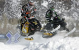 Blair Morgan (left) and Tucker Hibbert  race in a SnoCross practice at the ESPN Winter X Games ...