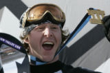 Nate Holland celebrate winning gold in the  winning medals  in the Snowboarder X  at the ESPN...