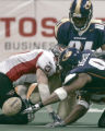 Las Vegas Gladiator wide reciever Joe Douglass, left, fumbles the ball in the third quarter of...