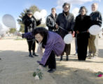 Westminster, CO Jan. 29, 2005 Christine Wolfe places a rose on the grave of her daughter, Vivian...