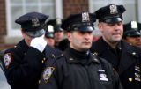 (NYT26) NEW YORK -- Feb. 8, 2006 -- NY-COP-SHOT -- Police outside a hospital in New York react to...