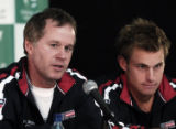 CADP106 - U.S. Davis Cup team captain Patrick McEnroe, left, answers a question as team member...